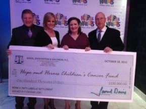 Davis, Saperstein & Salomon, P.C. donating check to New Jersey charity.
