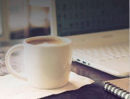 coffee and laptop on desk