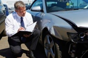 Practical legal advice for New Jersey auto accident victims is offered by an attorney examining a car crash.
