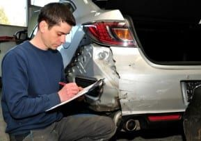 Man assesses a car's manufacturing defects after a New Jersey auto accident