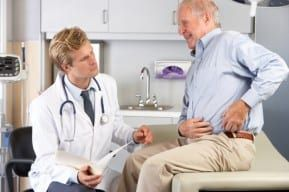 Doctor talks with New Jersey metal hip replacement side effects patient