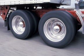 Tractor trailer truck tires roll off and break apart to cause New Jersey truck accident