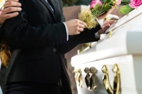 A funeral and a casket of a New Jersey wrongful death victim