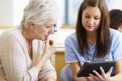Patient and nurse reviewing side effects of Taxotere chemotherapy drug