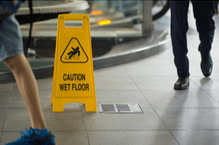 yellow sign to avoid slip and fall injuries
