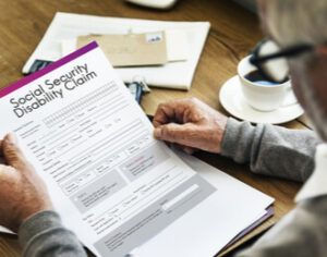person reading social security disability claim