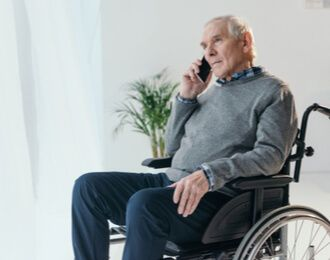 disabled person in wheelchair making a phone call