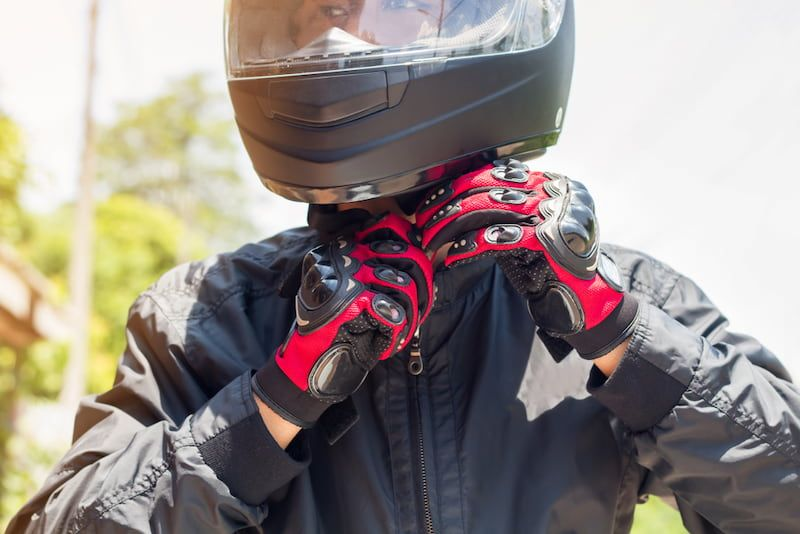 motorcycle driver putting on gloves