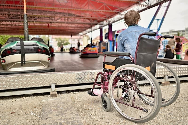 Woman in wheelchair watching on carousel