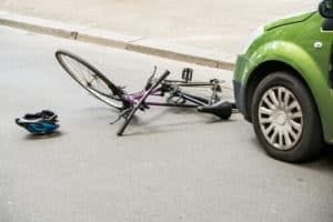 Damaged bicycle laying in the road