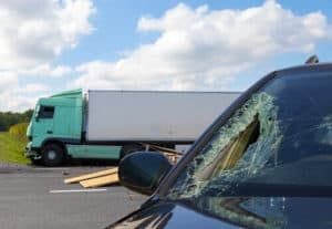 truck causes windshield damage to car