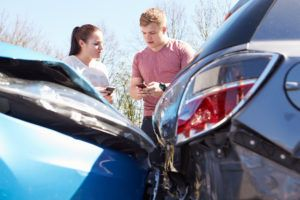 accident victims exchanging insurance information