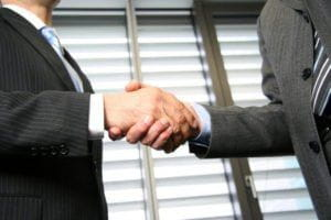 Handshake with Mediation Lawyer