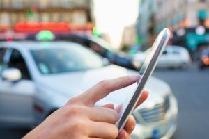 Distracted driver accident lawyers asks if cab hailing services are risky