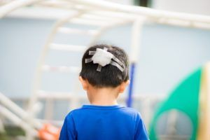 child with a bandage on his head
