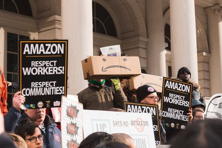 Amazon employees and community protesting poor working conditions in New York