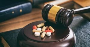 Judge's gavel and pills representing a dangerous medication lawsuit
