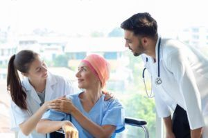 Colon cancer patient speaking with 2 doctors