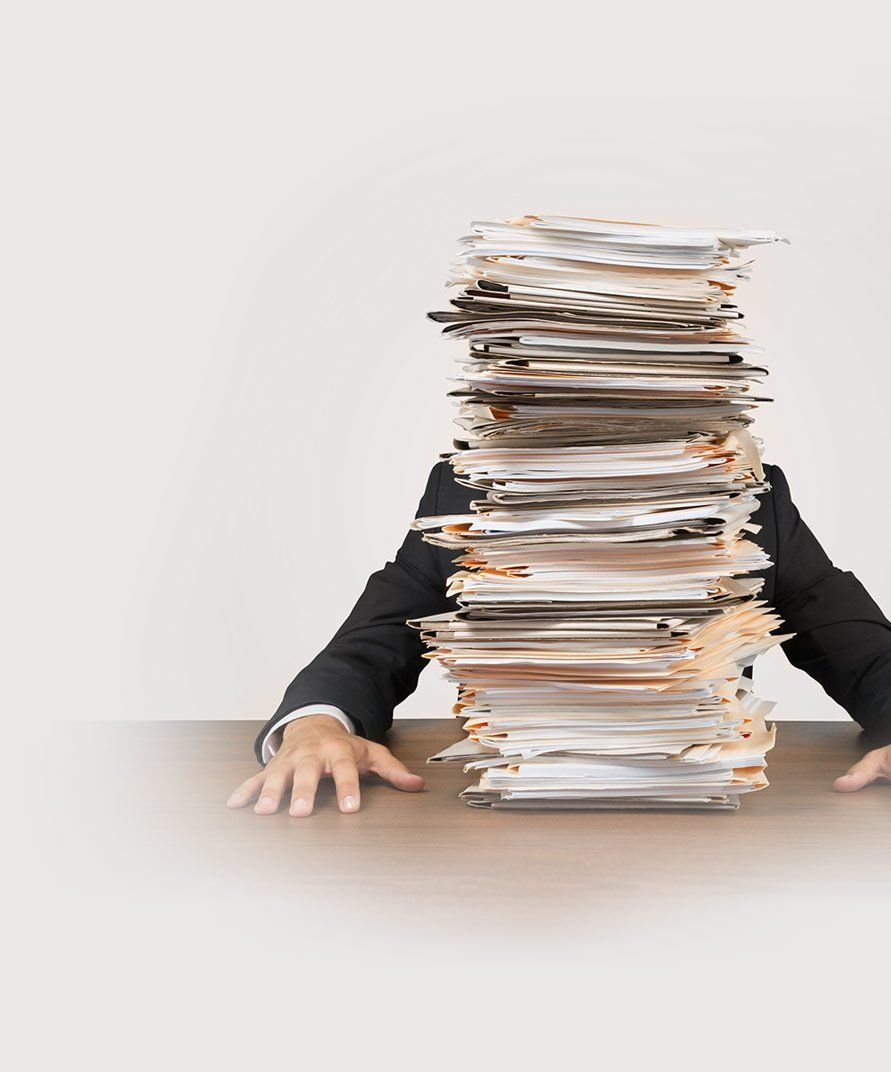 executor of estate blocked by large stack of paper and forms