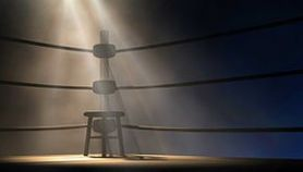 empty chair in boxing ring significant of beneficiary corner