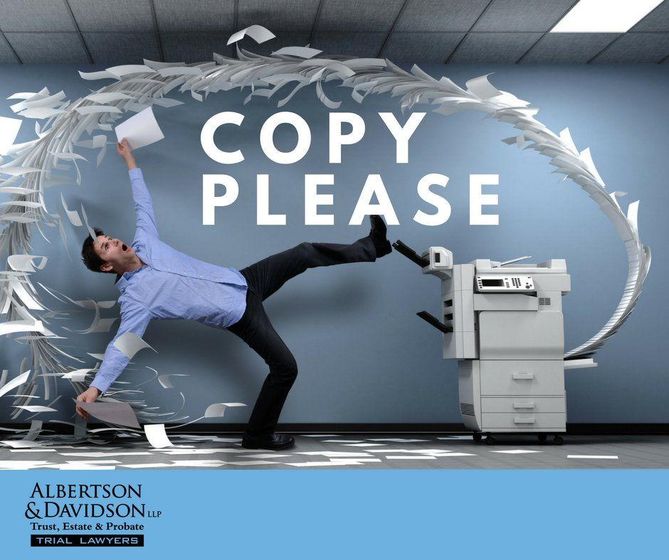 man overwhelmed by the copier machine