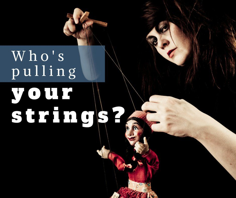 Who's pulling your strings photo of a marionette