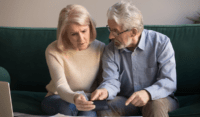 couple discussing about irrevocable trust beneficiary rights california