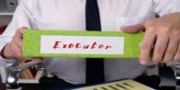 Man holding a folding with executor name