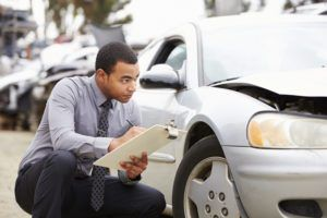 Shady Tricks Insurance Adjusters Might Use to Reduce Your Car Accident Claim - The Champion Firm