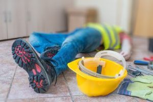 injured construction worker laying on the floor