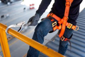 construction worker with safety harness on