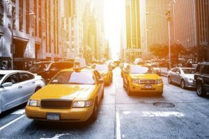 yellow taxi cabs on a street in NYC
