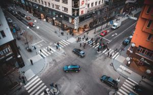 Cars at NYC Intersection as Pedestrians Use Crosswalk
