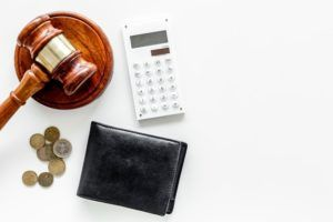 gavel, wallet, calculator and coins.