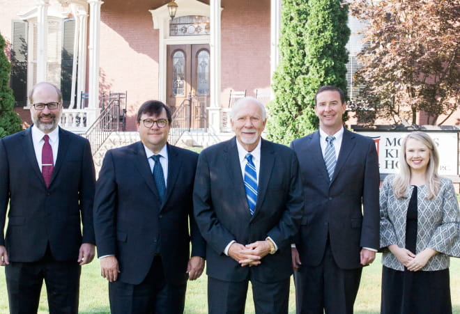 morris king hodge team in front of office building