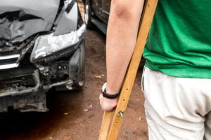 injured civilian in crutches involved in car accident