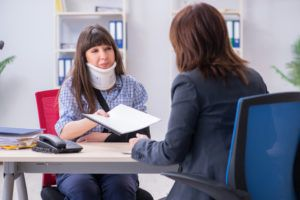 Injured employee visiting lawyer for advice on workers' compensation