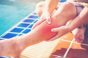 man with hurt leg after a swimming pool accident
