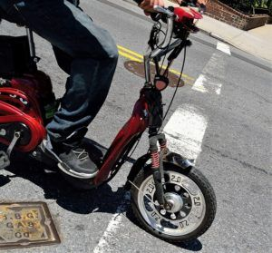 electric scooter causes accident