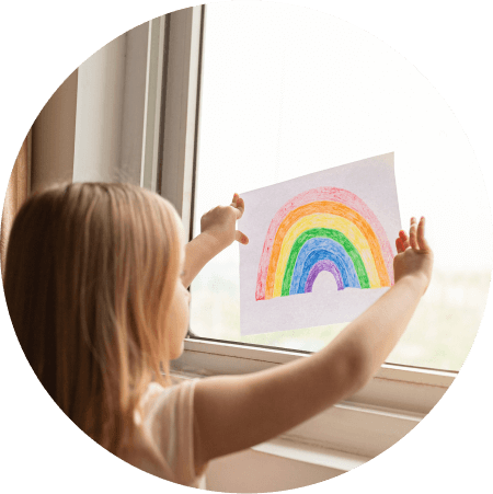 child with drawing of rainbow