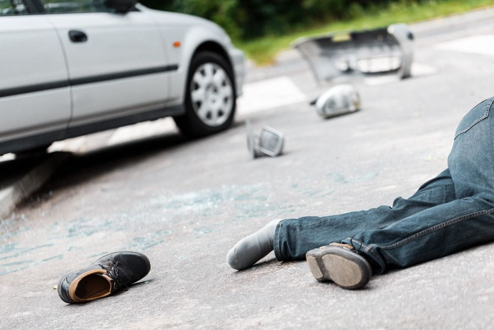 Drunk driver victim lying on the street
