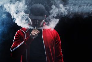 man vaping from an e-cigarette
