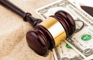 gavel on the money symbolizes workers compensation law