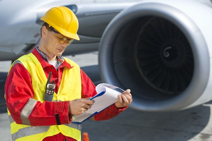 airplane engineer reviewing checklist