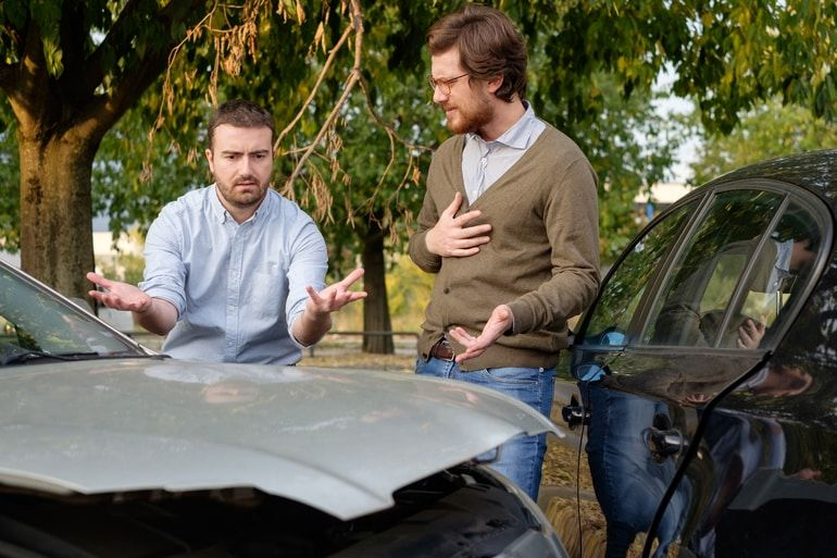 drivers arguing over car accident outside