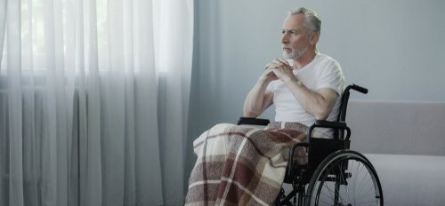 nursing home patient lookin out a window