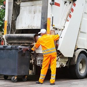 A Sanitation worker collecting garbages