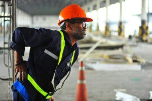 warehouse worker with back injuries as a result of repetitive motion