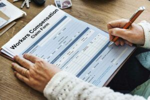man filling workers compensation form