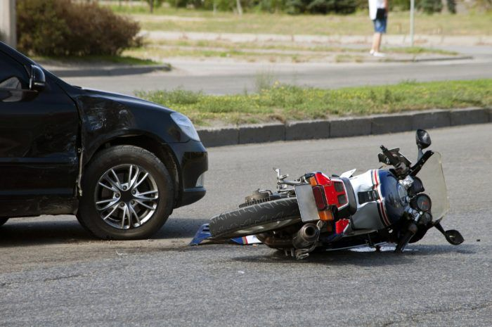 Motorcycle on its side after being in an accident